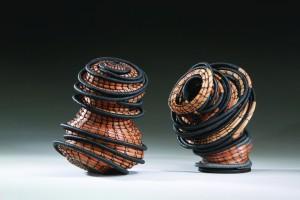 Peggy Wiedemann, The Pair (2 pieces, each piece is 8H x 6W x 6D, 1 lb), 2012. Weight_Pine needles, Irish waxed linen. Photo credit Jan Seeger.