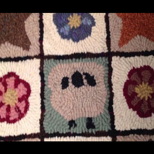 rug, featuring a lamb, multicolored flowers, and stars