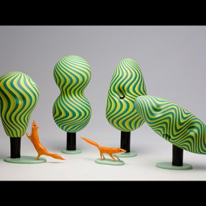 Blown, and sculpted, glass foxes, and trees
