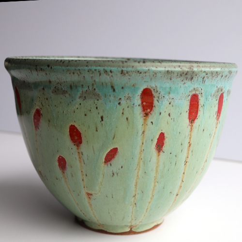 Green ceramic bowl with red poppies