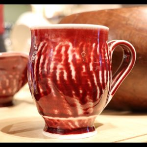 Red and white ceramic cup