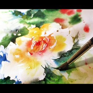 Yellow and red rose watercolor painting, and paintbrush