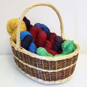 Green, Blue, red, and yellow yarn in a basket