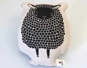 Sheep illustration on a pillow.
