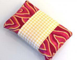 Kleenex holder with a red pattern.