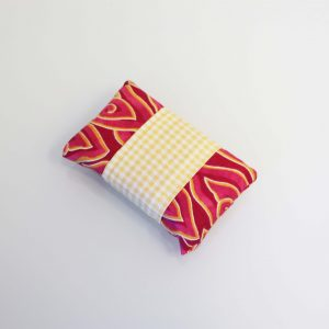 Tissue holder with a red pattern , and yellow stripe