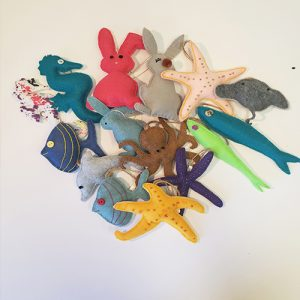 A group image of felt ornaments including seahorses, fish, rabbits, starfish, dolphin, and octopus