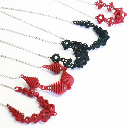 Geometric 3D printed necklaces in red and black.