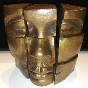 Bronze colored resin of a face in cube segments