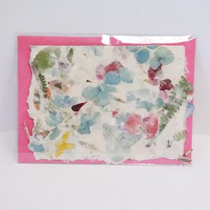 Floral themed card with pink envelope