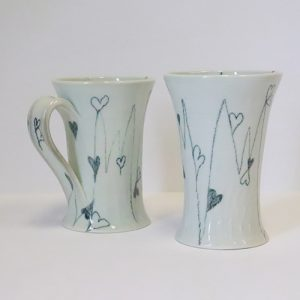 Mug and tumber with heart and line design