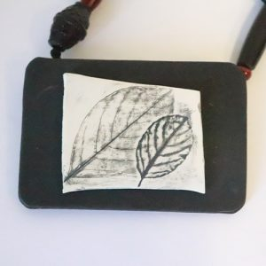 Black and white clay necklace, with gray leaves