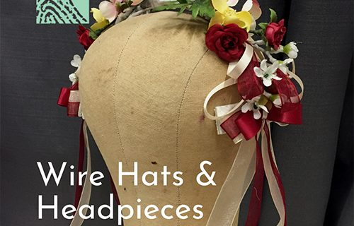 A wire headpieces with red and yellow flowers on a form.